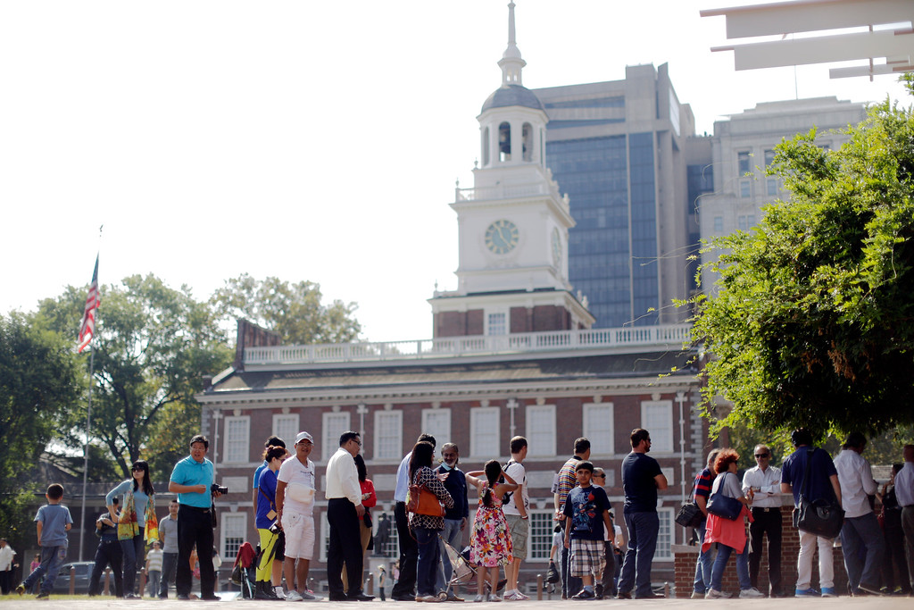 . Visitors to Independence National Historical Park stand in line in view of Independence Hall to look through a window of the closed building housing the Liberty Bell, Tuesday, Oct. 1, 2013, in Philadelphia.  (AP Photo/Matt Rourke)