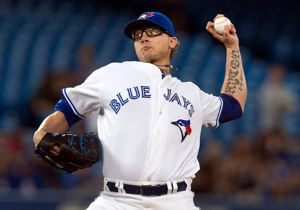 . Toronto Blue Jays pitcher Brett Cecil throws against the Colorado Rockies during the seventh inning of their interleague MLB baseball game in Toronto June 19, 2013.   REUTERS/Fred Thornhill