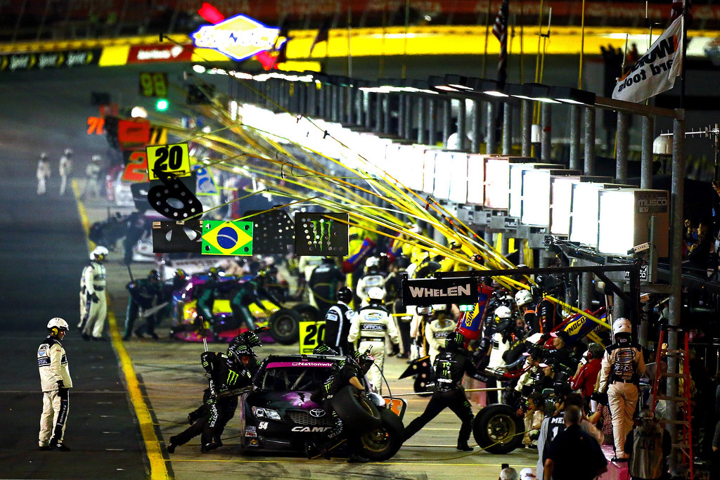 . CONCORD, NC - OCTOBER 11:  Kyle Busch, driver of the #54 Monster Energy Toyota, leads the field into the pits during the NASCAR Nationwide Series Dollar General 300 at Charlotte Motor Speedway on October 11, 2013 in Concord, North Carolina.  (Photo by Jonathan Ferrey/Getty Images)