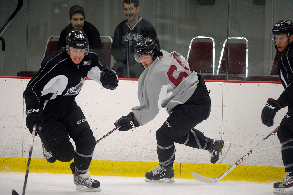 . Colorado Avalanche D Lee Moffie (50) races to the puck as Joseph Blandisi (64) during rookie camp practice September 10, 2013 at Family Sports. (Photo By John Leyba/The Denver Post)