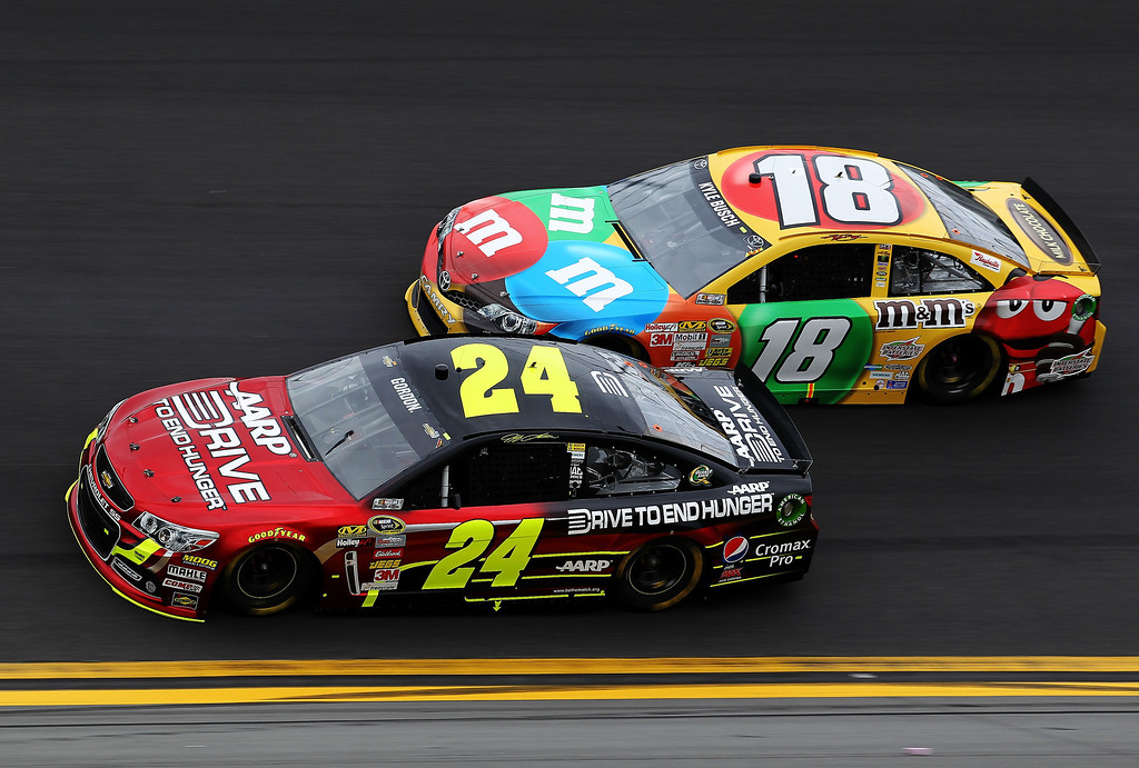 . Jeff Gordon #24 leads Kyle Busch, driver of the #18 M&M\'s Toyota, during the NASCAR Sprint Cup Series Daytona 500 at Daytona International Speedway on February 24, 2013 in Daytona Beach, Florida.  (Photo by Todd Warshaw/Getty Images)