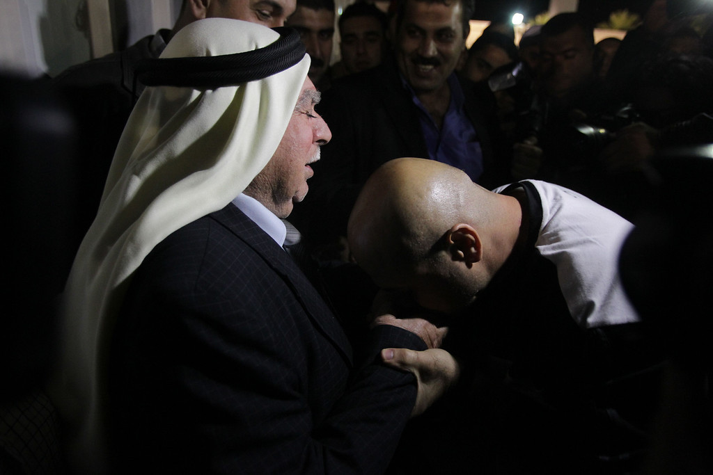 . A released Palestinian prisoner is greeted by his father upon his arrival in the West Bank City of Ramallah October 30, 2013.  Israel freed 26 Palestinian prisoners on Wednesday, the second stage of a limited amnesty designed to help U.S.-sponsored peace talks that have been dogged by divisions on both sides.  ABBAS MOMANI/AFP/Getty Images