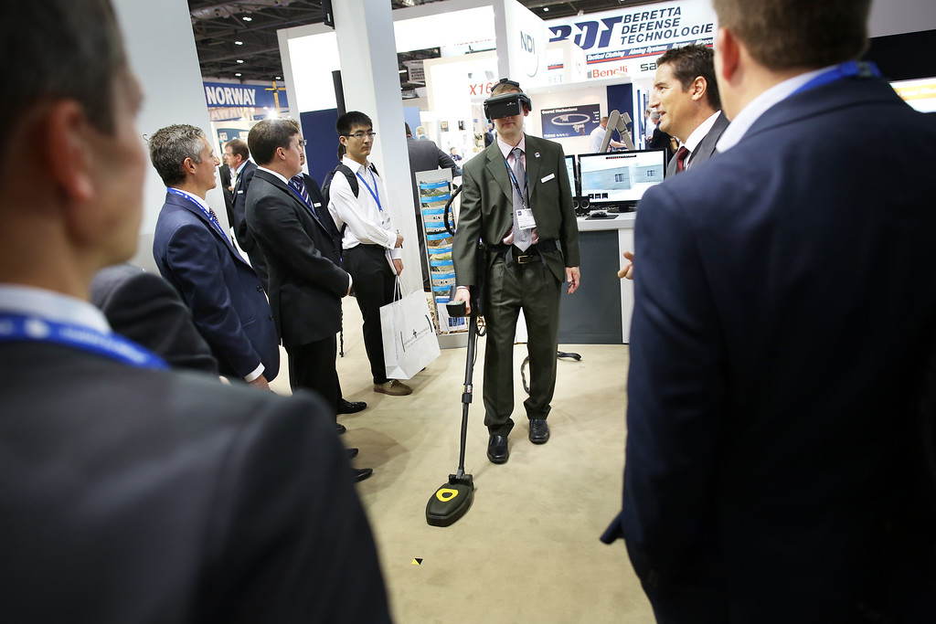. A man demonstrates a metal detector at the Defense and Security Exhibition on September 10, 2013 in London, England.  (Photo by Peter Macdiarmid/Getty Images)