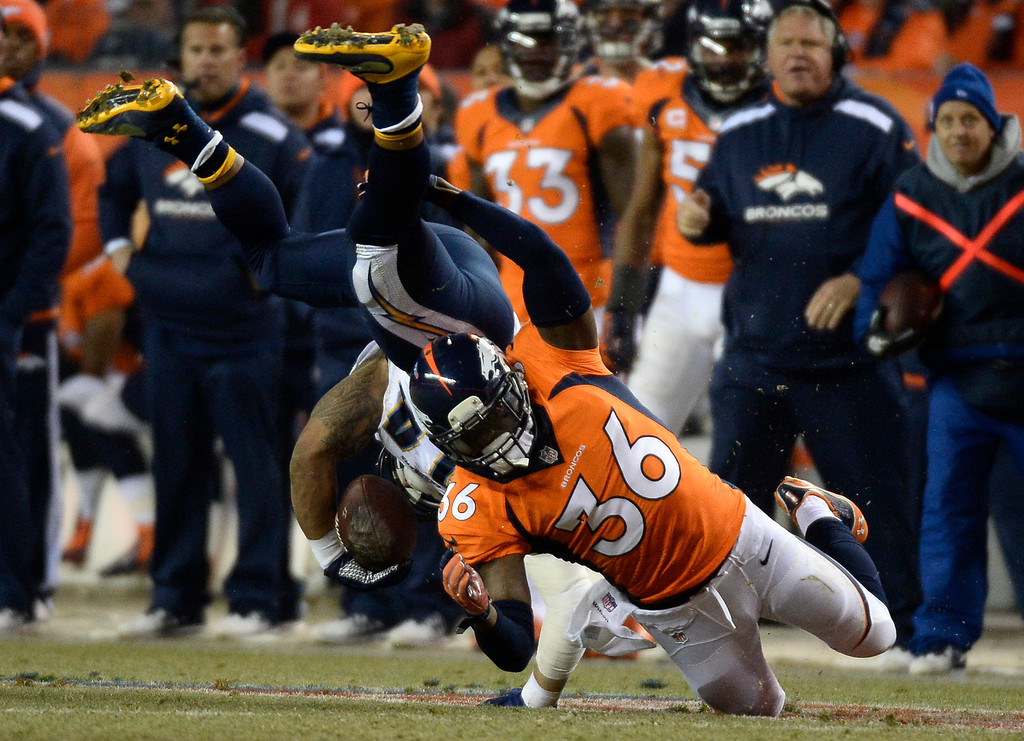 . Denver Broncos cornerback Kayvon Webster (36) takes down San Diego Chargers running back Ryan Mathews (24) during the third quarter. The Denver Broncos vs. the San Diego Chargers at Sports Authority Field at Mile High in Denver on December 12, 2013. (Photo by John Leyba/The Denver Post)