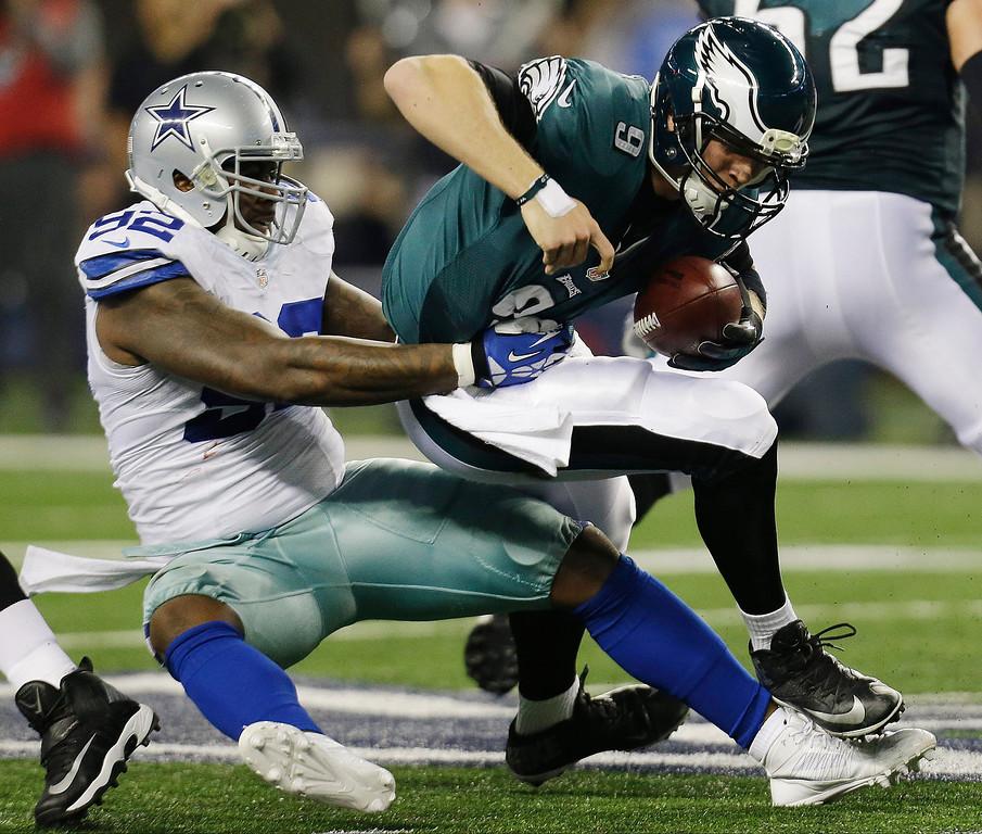 . Dallas Cowboys defensive end Jarius Wynn (92) sacks Philadelphia Eagles quarterback Nick Foles (9) during the first half of an NFL football game, Sunday, Dec. 29, 2013, in Arlington, Texas. (AP Photo/Tim Sharp)