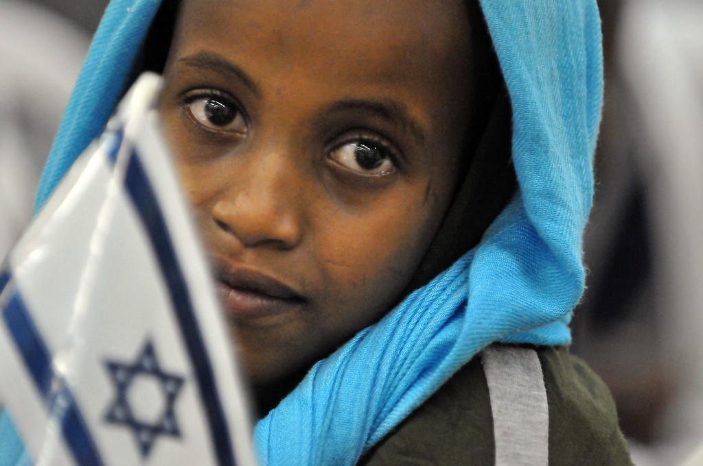 . Newly-arrived Jewish immigrants from Ethiopia are seen in Israel\'s Ben Gurion airport overnight on January 19, 2010. Eighty-one Ethiopian Jews were flown to Israel by the Jewish Agency, and a few more hundreds are about to come in the next weeks, after the Israeli government decided to renew the immigration of the Ethiopian Jews to Israel, the Jewish Agency said. YEHUDA RAIZNER/AFP/Getty Images