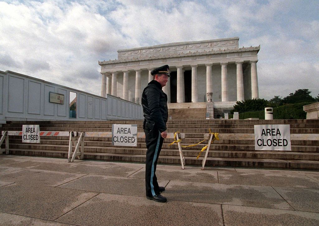 . In this  Wednesday, Nov. 15, 1995, file photo, U.S. Park Service Police Officer P.G. Carroll stands in front of closed signs at the Lincoln Memorial in Washington, during a partial shutdown of the federal government. There have been 17 government shutdowns since 1976, ranging in length from one to 21 days. (AP Photo/Charles Tasnadi, File)