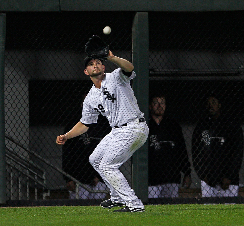 . Chicago White Sox left fielder Casper Wells catches a fly ball off the bat of New York Yankees\' Robinson Cano for the first out during the fourth inning of a baseball game at US Cellular Field in Chicago on Monday, Aug. 5, 2013. (AP Photo/Charles Cherney)