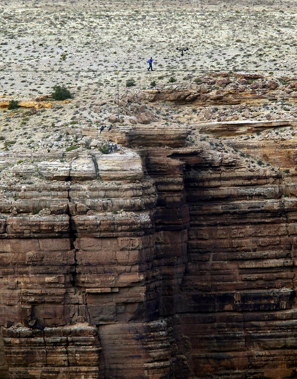 . Daredevil Nik Wallenda crosses a tightrope 1,500 feet above the Little Colorado River Gorge, Ariz., on Sunday, June 23, 2013, on the Navajo Nation outside the boundaries of Grand Canyon National Park. AP Photo/Rick Bowmer)