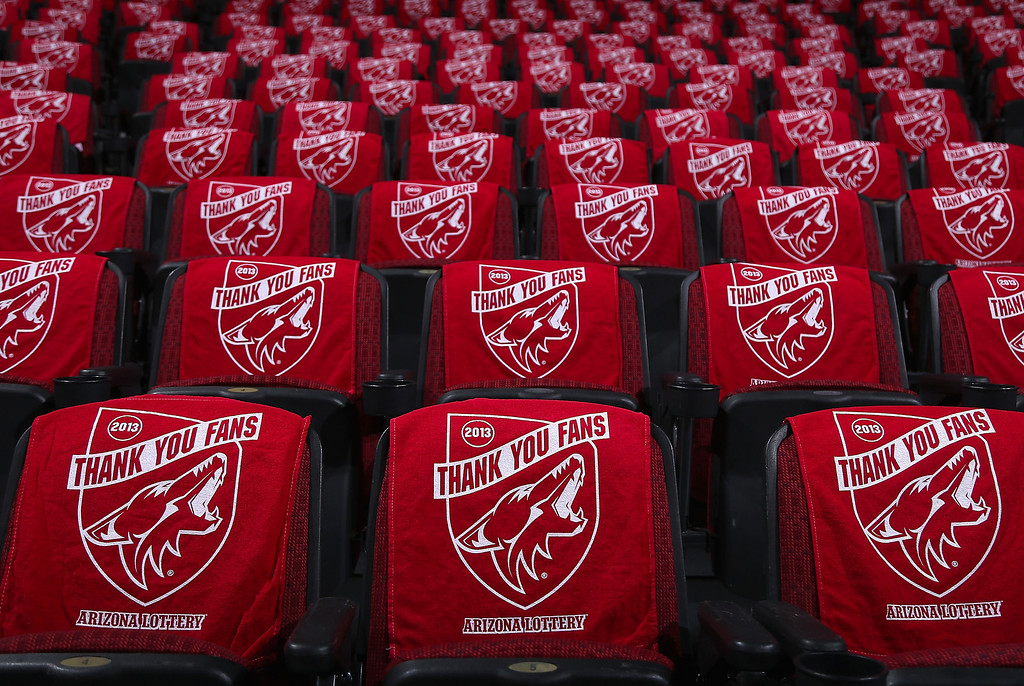 ". GLENDALE, AZ - APRIL 26:  Towels that read ""Thank You Fans\"" are drapped over seats before the NHL game between the Phoenix Coyotes and Colorado Avalanche at Jobing.com Arena on April 26, 2013 in Glendale, Arizona.  (Photo by Christian Petersen/Getty Images)"