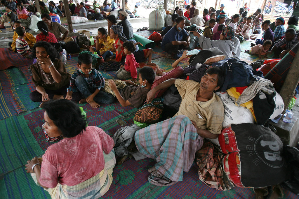. Villagers who were evacuated from their homes following Mount Sinabung\'s eruption rest in a temporary shelter in Tiga Nderket, North Sumatra, Indonesia, Monday, Nov. 4, 2013. The volcano erupted Sunday, unleashing volcanic ash high into the sky and forcing the evacuation of villagers living around its slope. (AP Photo/Binsar Bakkara)