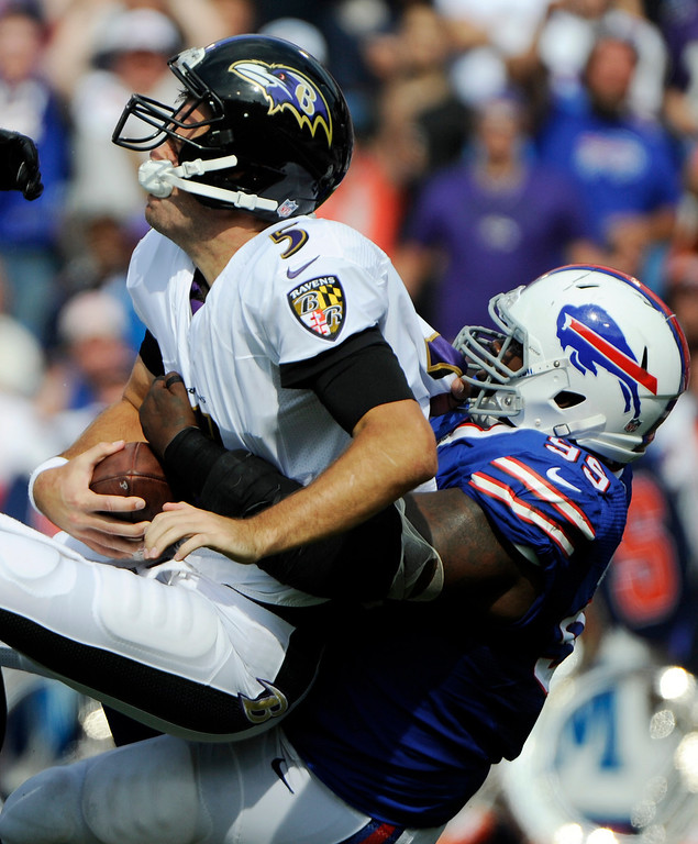 . Baltimore Ravens quarterback Joe Flacco (5) is sacked by Buffalo Bills defensive tackle Marcell Dareus (99) during the first half of an NFL football game on Sunday, Sept. 29, 2013, in Orchard Park, N.Y. (AP Photo/Gary Wiepert)