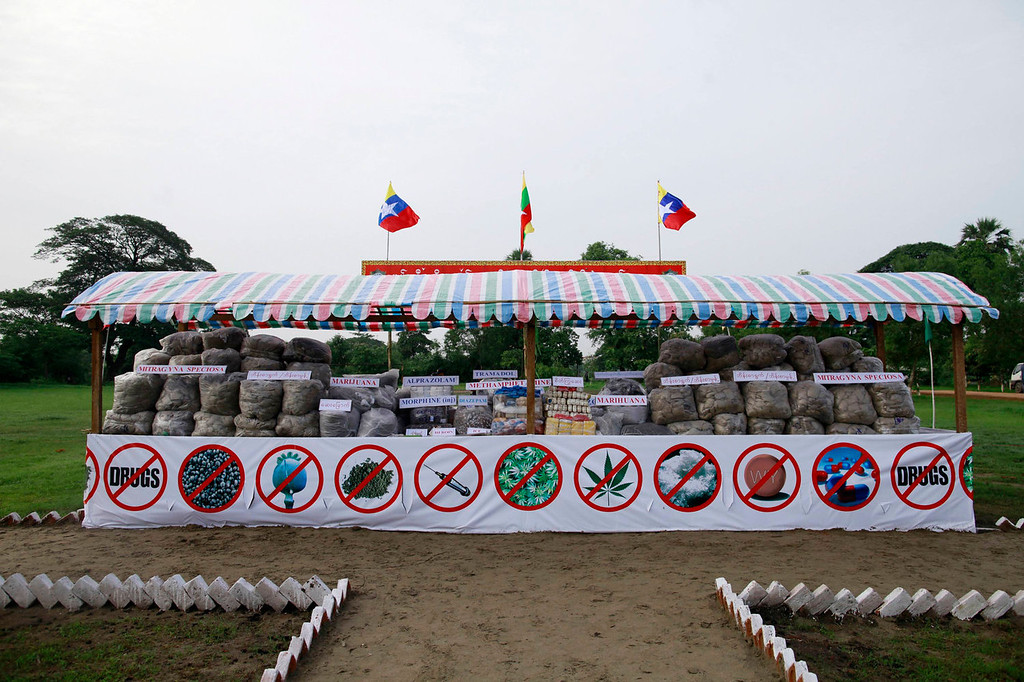 . Seized drugs are displayed before they are burnt and destroyed at an event to mark International Day against Drug Abuse and Illicit Trafficking outside Yangon June 26, 2013. The government destroyed $77 million worth of drugs in Yangon, Mandalay and Taunggyi.  REUTERS/Soe Zeya Tun