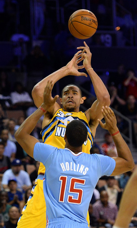 . JaVale McGee #34 of the Denver Nuggets shoots over Ryan Hollins #15 of the Los Angeles Clippers during their preseason game at the Mandalay Bay Events Center on October 19, 2013 in Las Vegas, Nevada. Los Angeles won 118-111 in overtime.    (Photo by Ethan Miller/Getty Images)