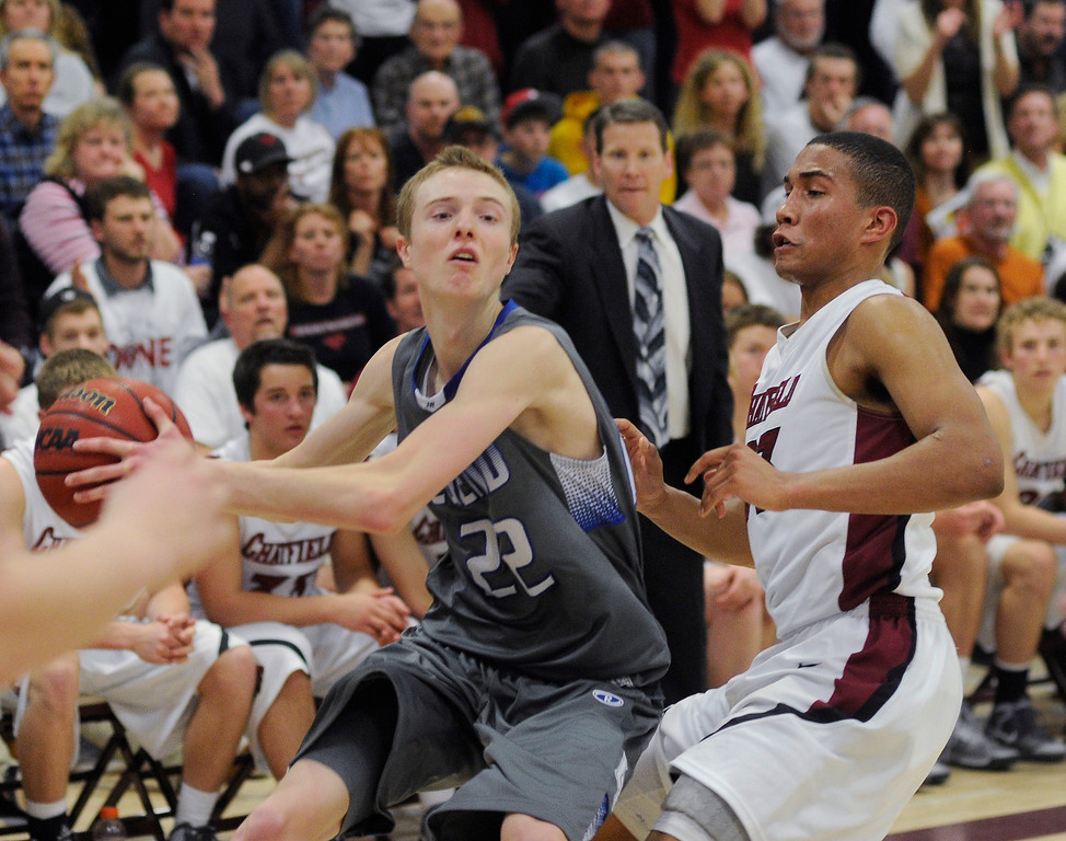 . LITTLETON, CO. - MARCH 6: Legend senior Taylor Jensen (22) took an inbound pass late in the second half forcing Chatfield\'s Anthony Shoeboot to make the intentional foul on Jensen. The Legend High School boy\'s basketball team upset Chatfield 51-49  in a playoff game Wednesday night, March 6, 2013. (Photo By Karl Gehring/The Denver Post)