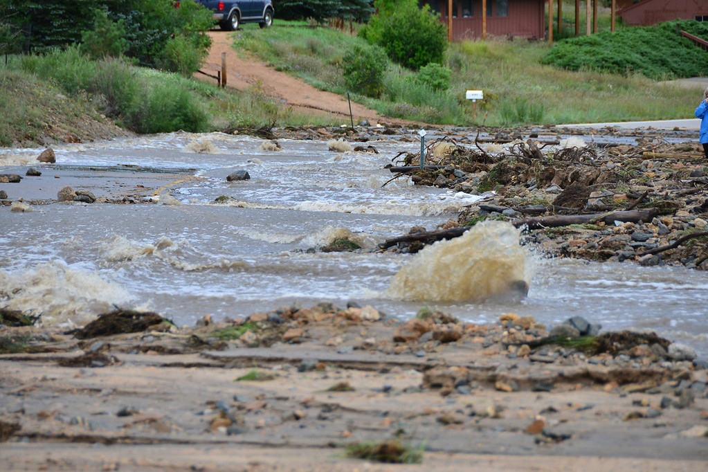 . Fish Creek was a raging torrent flowing down Fish Creek Road Saturday morning, September 14, 2013. Officials said as of Saturday the creek had breached its banks in nine locations. John Cordsen/Estes Park Trail-Gazette