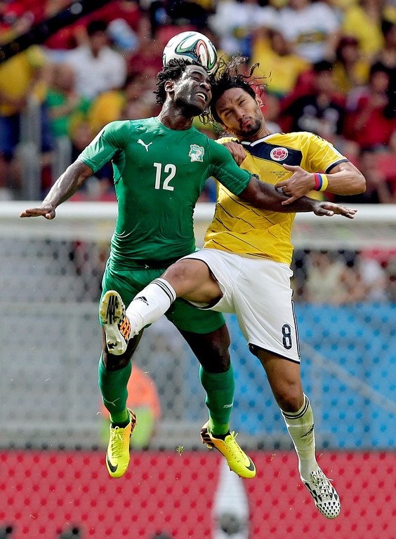 . Ivory Coast\'s Wilfried Bony (12) and Colombia\'s Abel Aguilar (8) battle for the ball during the group C World Cup soccer match between Colombia and Ivory Coast at the Estadio Nacional in Brasilia, Brazil, Thursday, June 19, 2014. (AP Photo/Marcio Jose Sanchez)