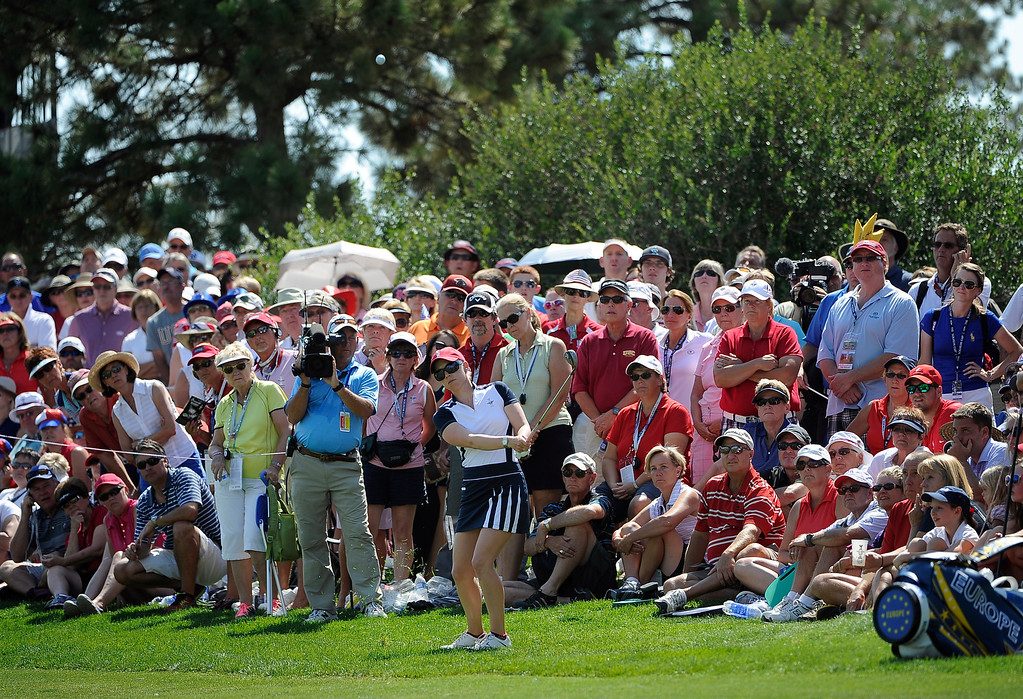 . PARKER, CO - Aug.17: Team USA\'s Morgan Pressel hits her ball on to the 16th green. The 2013 Solheim Cup takes place at the Colorado Golf Club with the USA taking on Europe in the Saturday morning Foursomes Match. (Photo By Kathryn Scott Osler/The Denver Post)