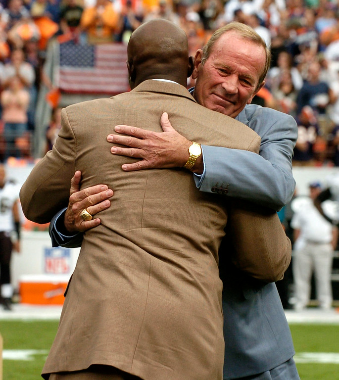 . Former Denver Bronco Terrell Davis hugs Broncos owner Pat Bowlen during half time after being inducted into the ring of fame on Sunday September 23rd, 2007 at Invesco Field at Mile High in Denver, CO.  John Leyba / The Denver Post