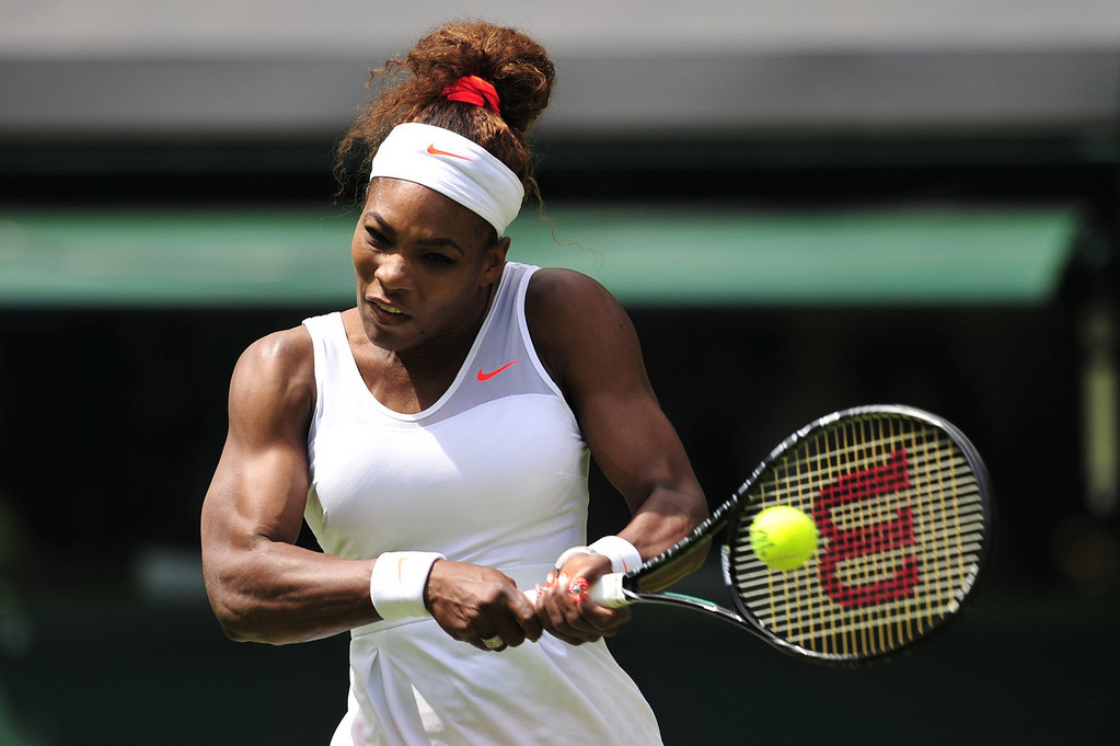 . US player Serena Williams returns against Luxembourg\'s Mandy Minella during their women\'s first round match on day two of the 2013 Wimbledon Championships tennis tournament at the All England Club in Wimbledon, southwest London, on June 25, 2013.  GLYN KIRK/AFP/Getty Images