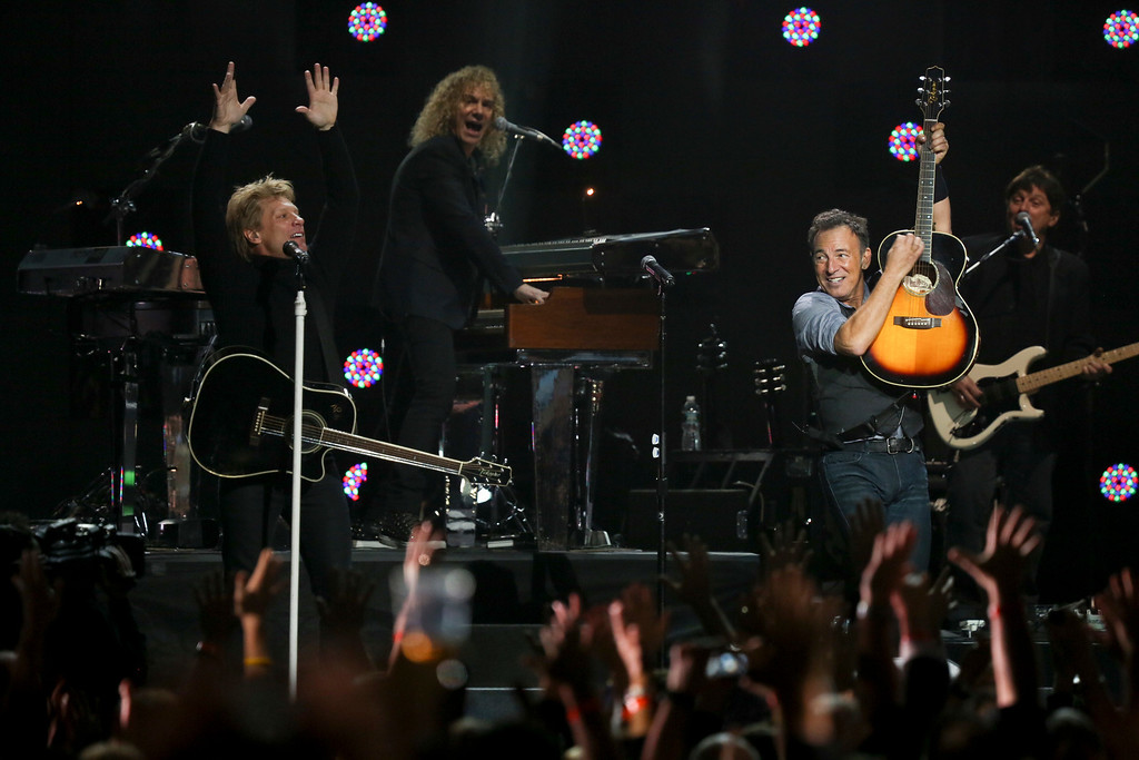 """. Jon Bon Jovi and Bruce Springsteen perform \""""Who Says You Can\'t Go Home\""""  during the 12-12-12 benefit concert for victims of Hurricane Sandy, at Madison Square Garden in New York, Dec. 12, 2012. The concert features a lineup of artists spanning five decades. (Damon Winter/The New York Times)"""