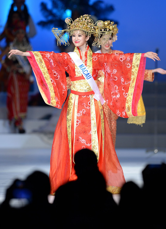 . Clad in national costume, Adela Ka-Wai Sou of Macau appears on stage during the 53rd Miss International Beauty Pageant in Tokyo on December 17, 2013.      TORU YAMANAKA/AFP/Getty Images