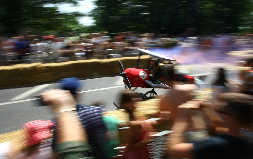 . A team makes their way down the course at Alexandra Palace on July 14, 2013 in London, England. The Red Bull Soapbox Race returned to London after nine years and encourages competitors to build and race their own homemade soapboxes down a hill.  (Photo by Jordan Mansfield/Getty Images)
