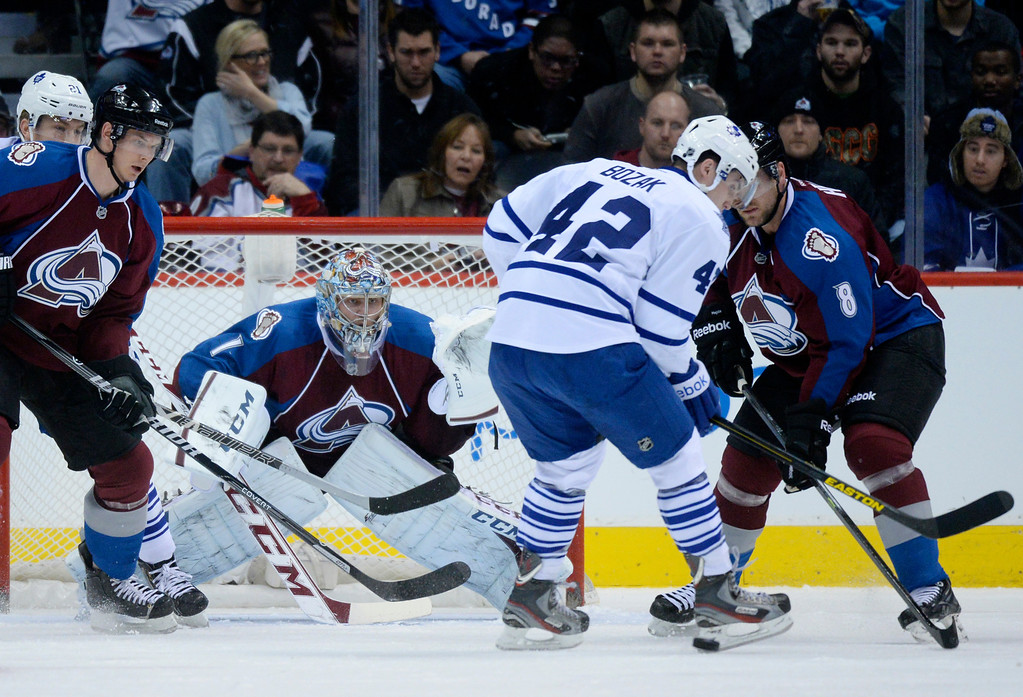 . DENVER, CO. - JANUARY 21:  Toronto center Tyler Bozak (42) had the puck slide behind him in front of the net in the first period. The Colorado Avalanche hosted the Toronto Maple Leafs Tuesday night, January 21, 2014 at the Pepsi Center. Photo By Karl Gehring/The Denver Post