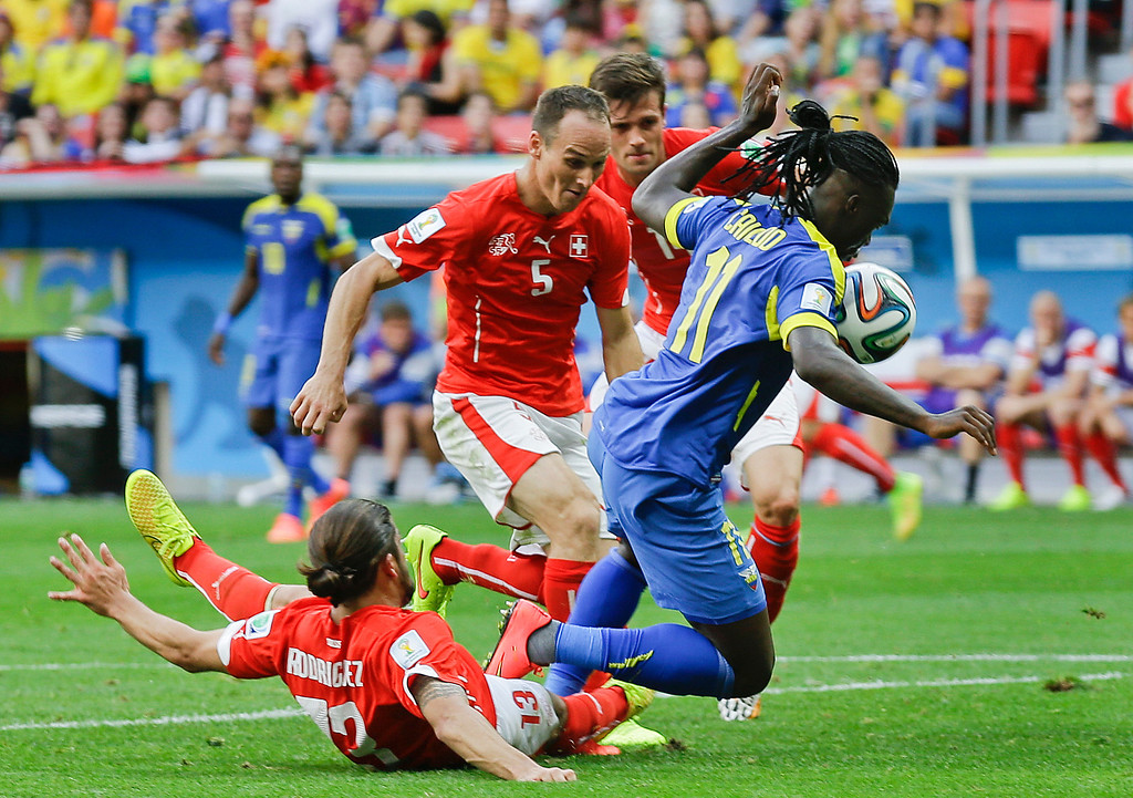. Ecuador\'s Felipe Caicedo, right, goes to the ground after being challenged in the penalty area during the group E World Cup soccer match between Switzerland and Ecuador at the Estadio Nacional in Brasilia, Brazil, Sunday, June 15, 2014.  No penalty was awarded. (AP Photo/Martin Mejia)