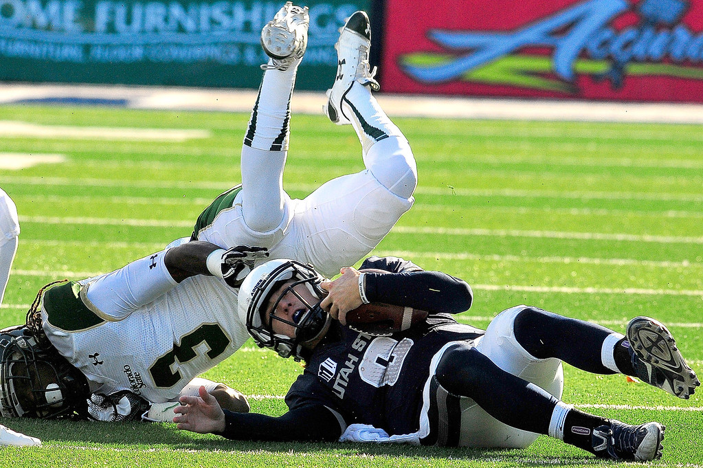 . Utah State quarterback Darrell Garretson gets tackled by Colorado State\'s Shaq Bell (3) during an NCAA college football game, Saturday, Nov. 23, 2013, in Logan, Utah. Utah State won 13-0. (AP Photo/Herald Journal, John Zsiray)