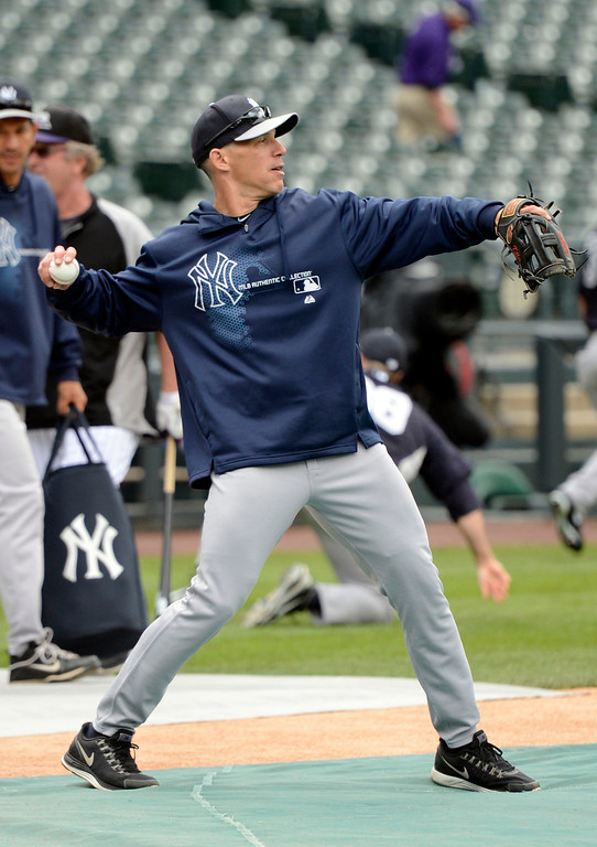 . DENVER, CO. - MAY 07: Joe Girardi (28) of the New York Yankees warms up his arm during batting practice prior to their game against the Colorado Rockies May 7, 2013 at Coors Field. (Photo By John Leyba/The Denver Post)