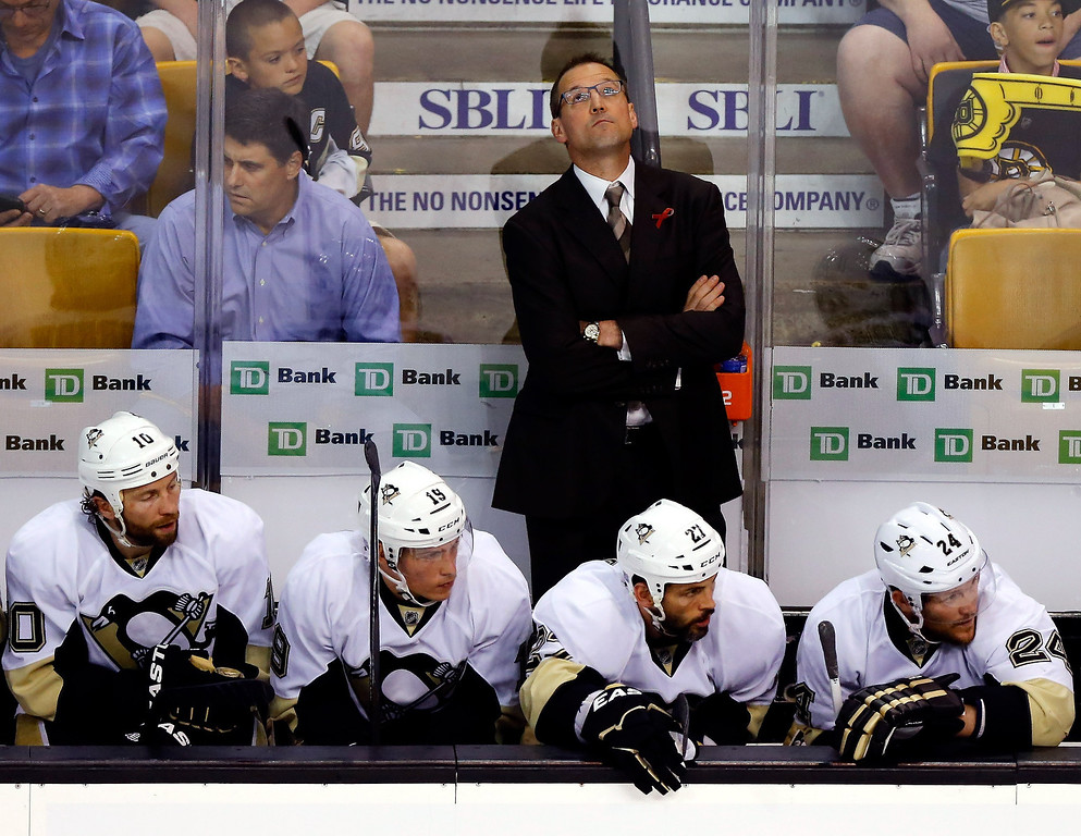 . Dan Bylsma of the Pittsburgh Penguins looks at the scoreboard against the Boston Bruins during Game Three of the Eastern Conference Final of the 2013 NHL Stanley Cup Playoffs at the TD Garden on June 5, 2013 in Boston, Massachusetts.  (Photo by Jared Wickerham/Getty Images)