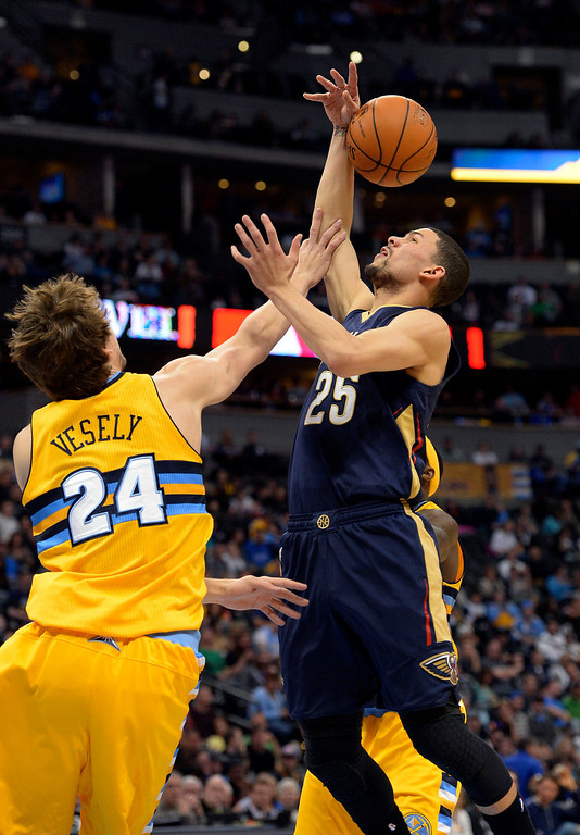 . Denver Nuggets forward Jan Vesely (24) blocks a shot by New Orleans Pelicans guard Austin Rivers (25) during the first quarter April 2, 2014 at the Pepsi Center in Denver. (Photo by John Leyba/The Denver Post)