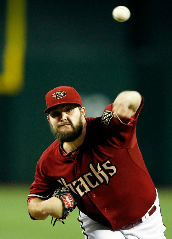 . Arizona Diamondbacks starting pitcher Wade Miley throws in the first inning during a baseball game against the Colorado Rockies, Sunday, Aug. 10, 2014, in Phoenix. (AP Photo/Rick Scuteri)