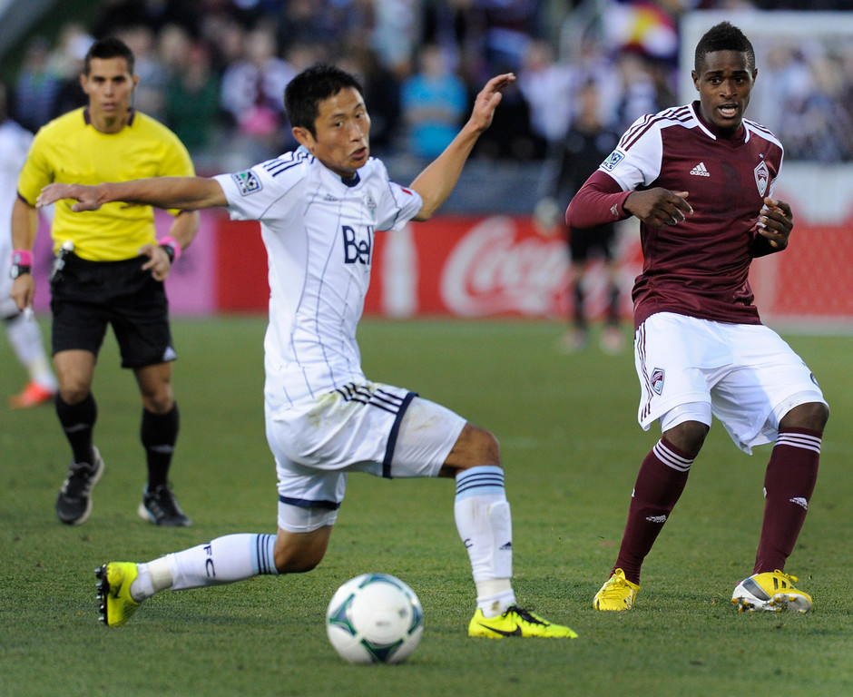 . COMMERCE CITY, CO. - OCTOBER 19: Colorado midfielder Deshorn Brown (26) pushed a pass past Vancouver\'s Lee Young-Pyo (12) in the second half. The Colorado Rapids defeated the Vancouver Whitecaps 3-2 at Dick\'s Sporting Goods Park Saturday, October 19, 2013. Photo By Karl Gehring/The Denver Post