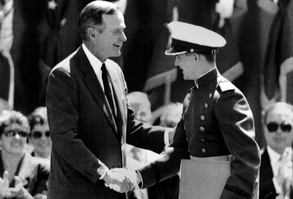 . Cadet James P. Dutton, of Eugene, Ore., is congratulated by President Bush Wednesday at the U.S. Air Force Academy graduation ceremonies. Dutton maintained a 3.99 academic grade point average to graduate top in his class. (AP LaserPhoto)  (str/David Zalubowski) 1991. The Denver Post Library Archive