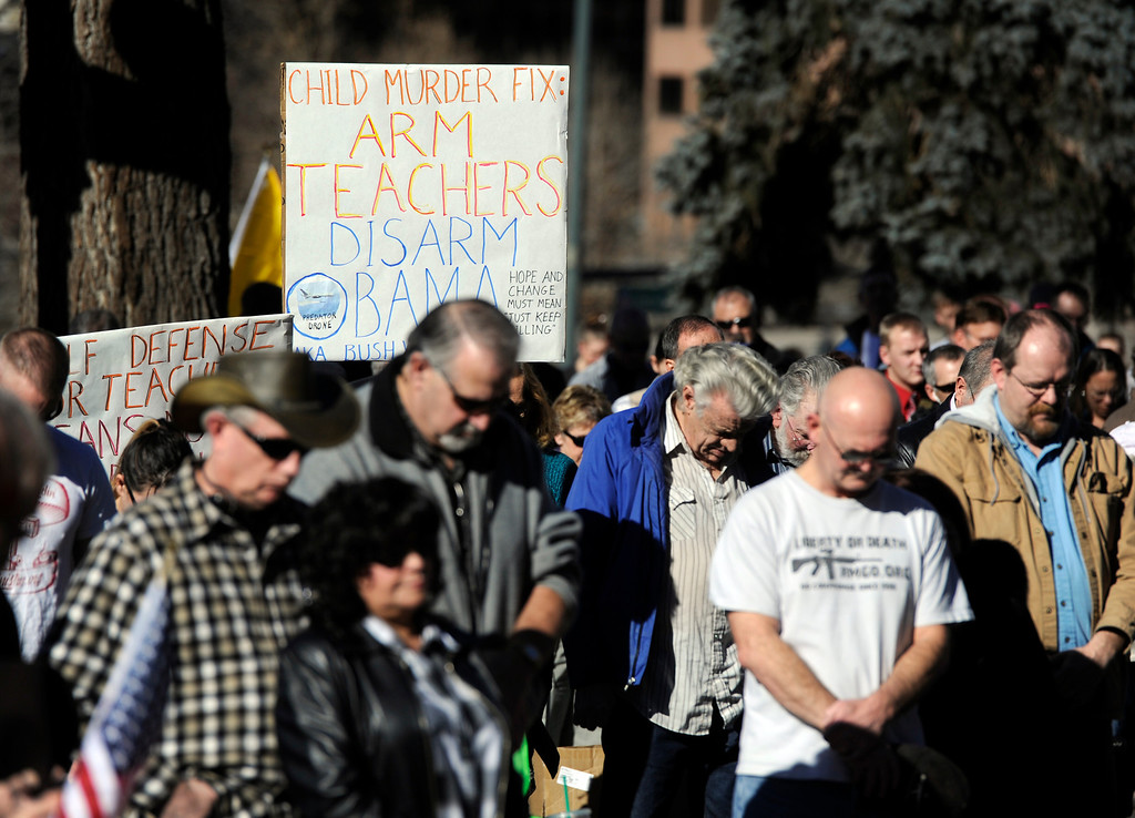 . DENVER, CO. - JANUARY  19: Pro gun supporters bow their heads for prayer during a rally at the Colorado State Capitol Saturday afternoon, January 19th, 2013.  (Photo By Andy Cross / The Denver Post)