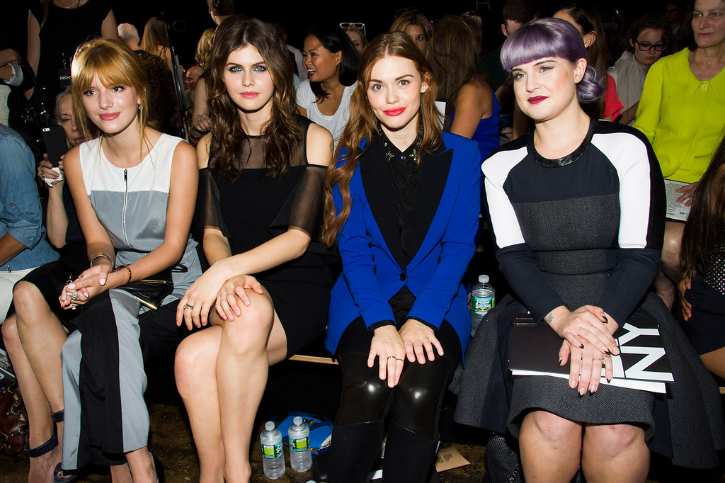. Bella Thorne, from left, Alexandra Daddario, Holland Roden and Kelly Osbourne attend the DKNY collection on Sunday, Sept. 8, 2013, during Mercedes-Benz Fashion Week in New York. (Photo by Charles Sykes/Invision/AP)
