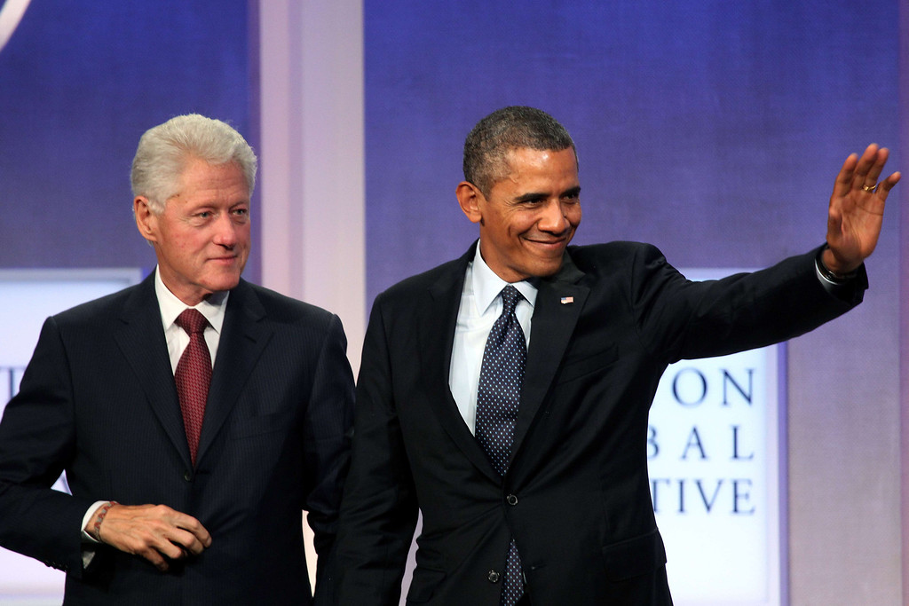 . US President Barack Obama (R) and former US president Bill Clinton (L) attend the Clinton Global Initiative (CGI) on September 24, 2013 in New York. MEHDI TAAMALLAH/AFP/Getty Images