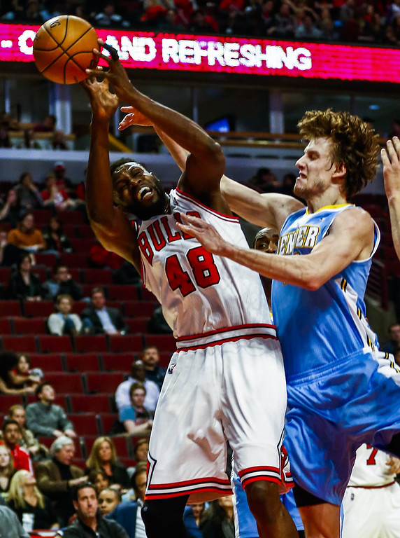. Chicago Bulls center Nazr Mohammed (L) is fouled by Denver Nuggets forward Jan Vesely of the Czech Republic (R) in the second half of their NBA game at the United Center in Chicago, Illinois, USA, 21 February 2014. The Bulls defeated the Nuggets.  EPA/TANNEN MAURY