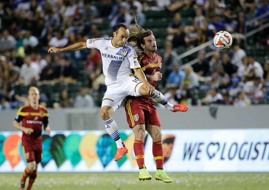 . Los Angeles Galaxy\'s Landon Donovan, front left, and Real Salt Lake\'s Kyle Beckerman jump for a header during the second half of their MLS soccer match on Saturday, July 12, 2014, in Carson, Calif. The Galaxy won 1-0. (AP Photo/Jae C. Hong)