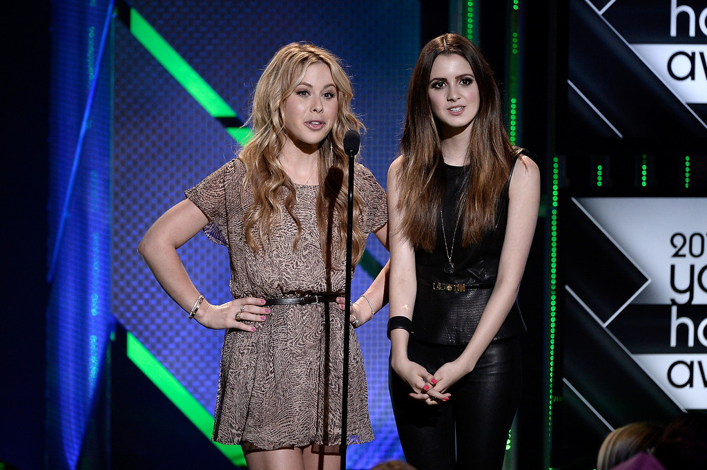 . Actresses Tara Lipinski (L) and Laura Marano speak onstage during CW Network\'s 2013 Young Hollywood Awards presented by Crest 3D White and SodaStream held at The Broad Stage on August 1, 2013 in Santa Monica, California.  (Photo by Kevin Winter/Getty Images for PMC)
