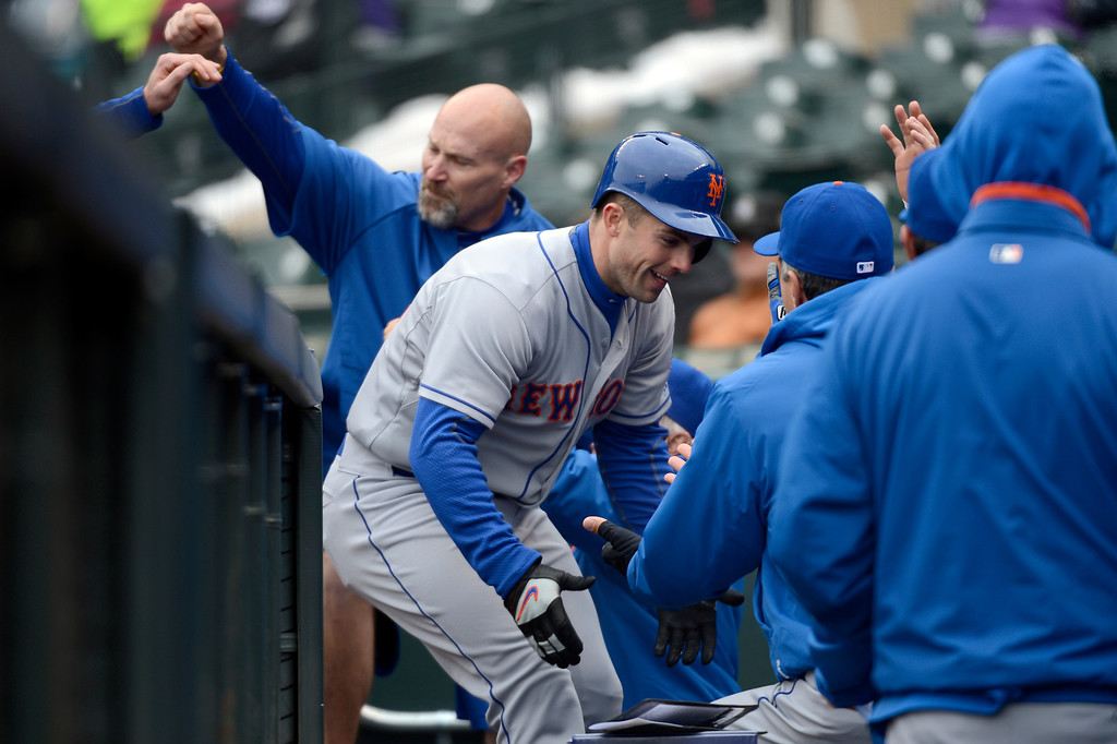. David Wright of the New York Mets high fives teammates in the dugout after hitting a home run in the first inning April 16, 2013 at Coors Field. Both teams wore the number 42 on their jersey in honor of Jackie Robinson. (Photo By John Leyba/The Denver Post)