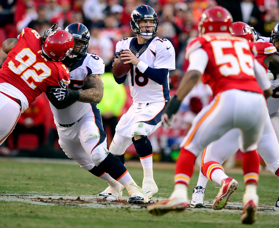 . Peyton Manning (18) of the Denver Broncos works the pocket against the Kansas City Chiefs during the first half at Arrowhead Stadium.  (Photo by AAron Ontiveroz/The Denver Post)