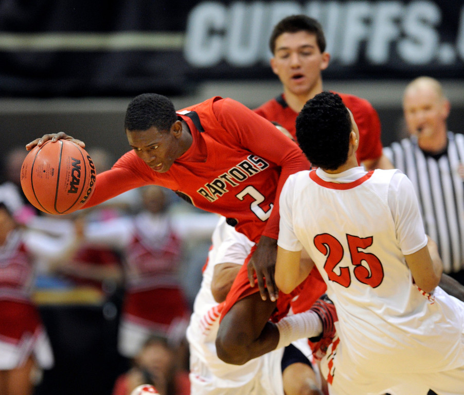 . BOULDER, CO. - MARCH 16: Raptor guard TreShawn Wilford (2) collided with East\'s Ronnie Harrell (25) in the second half. The Eaglecrest High School boy\'s basketball beat Denver East 63-44 in the 5A championship game Saturday, March 16, 2013 at the Coors Events Center in Boulder.  (Photo By Karl Gehring/The Denver Post)