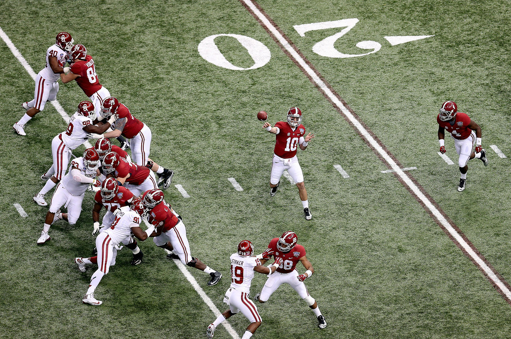 . NEW ORLEANS, LA - JANUARY 02:  AJ McCarron #10 of the Alabama Crimson Tide passes against the Oklahoma Sooners during the Allstate Sugar Bowl at the Mercedes-Benz Superdome on January 2, 2014 in New Orleans, Louisiana.  (Photo by Sean Gardner/Getty Images)