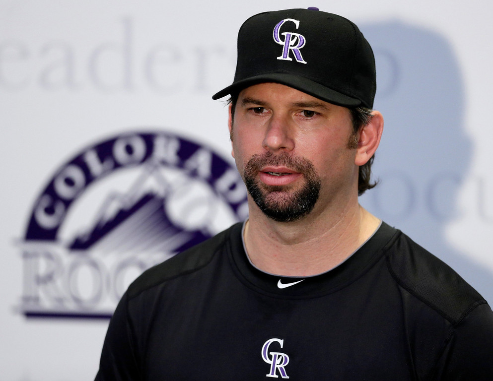 . Colorado Rockies\' Todd Helton responds to a question during a news conference following a spring training baseball workout, Sunday, Feb. 17, 2013, in Scottsdale, Ariz. (AP Photo/Darron Cummings)