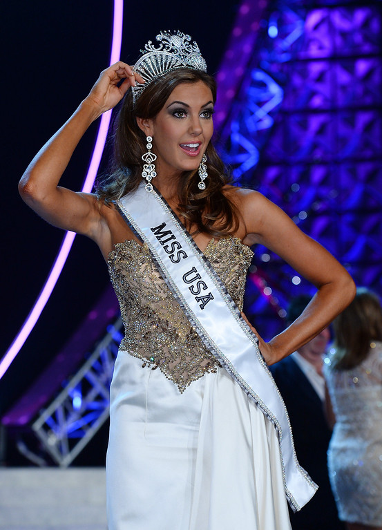. Miss Connecticut USA Erin Brady touches her crown as she poses onstage after winning the 2013 Miss USA pageant at PH Live at Planet Hollywood Resort & Casino on June 16, 2013 in Las Vegas, Nevada.  (Photo by Ethan Miller/Getty Images)