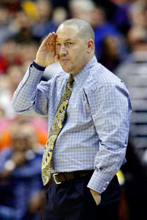 . Head coach Buzz Williams gestures from the sidelines against the Syracuse Orange during the East Regional Round Final of the 2013 NCAA Men\'s Basketball Tournament at Verizon Center on March 30, 2013 in Washington, DC.  (Photo by Rob Carr/Getty Images)