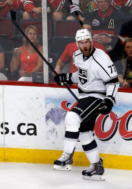 . Los Angeles Kings center Jeff Carter (77) reacts after scoring a goal against the Chicago Blackhawks during the first period in Game 7 of the Western Conference finals in the NHL hockey Stanley Cup playoffs Sunday, June 1, 2014, in Chicago. (AP Photo/Charles Rex Arbogast)